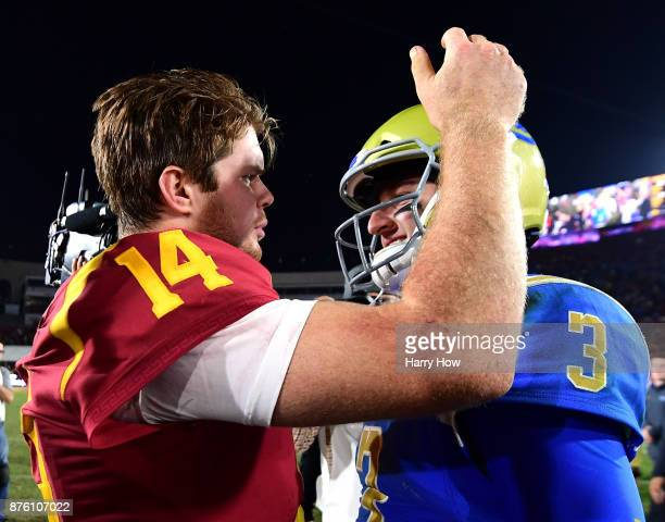 Josh Rosen of the UCLA Bruins and Sam Darnold of the USC Trojans meet on the field after a 2823 Trojan win at Los Angeles Memorial Coliseum on...