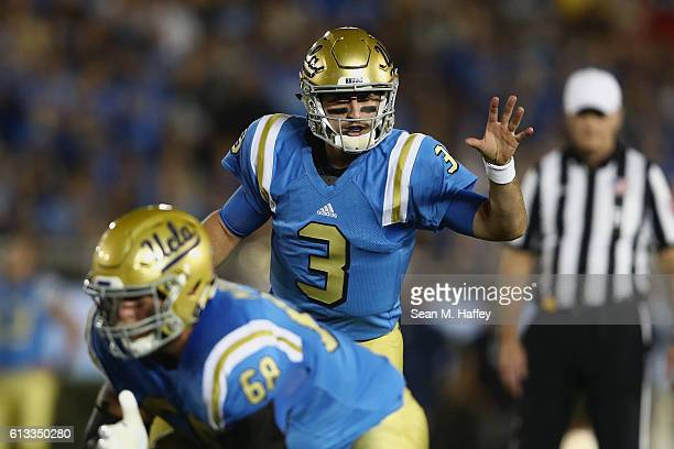 Josh Rosen of the UCLA Bruins calls a play at the line of scrimmage during the first half of a game against the Arizona Wildcats at the Rose Bowl on...