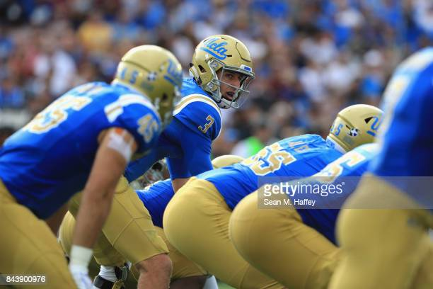 Josh Rosen of the UCLA Bruins calls a playduring the first half of a game against the Texas AM Aggies at the Rose Bowl on September 3 2017 in...
