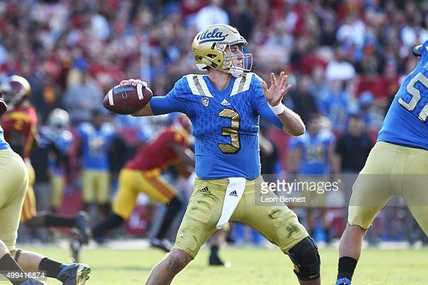 Josh Rosen of the UCLA Bruins looking to past the ball against the USC Trojans a 4021 Trojan win over the UCLA Bruins in a NCAA PAC12 college...