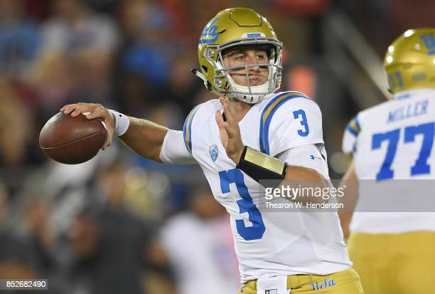 Josh Rosen of the UCLA Bruins looks to pass against the Stanford Cardinal during the first quarter of their NCAA football game at Stanford Stadium on...