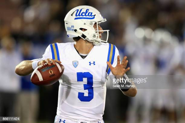 Josh Rosen of the UCLA Bruins looks to pass during the second half of a game against the Colorado Buffaloes at the Rose Bowl on September 30 2017 in...