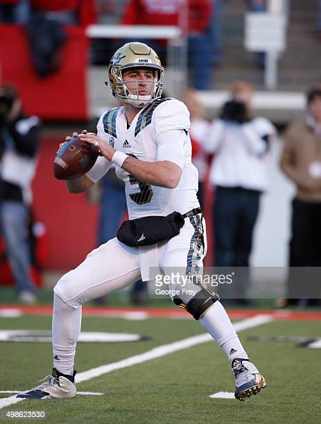 Josh Rosen of the UCLA Bruins looks to pass the ball against the Utah Utes during the first half of a college football game at Rice Eccles Stadium on...
