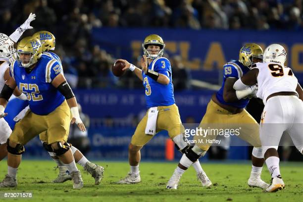 Josh Rosen of the UCLA Bruins looks to passes during the first half of a game against the Arizona State Sun Devils at the Rose Bowl on November 11...