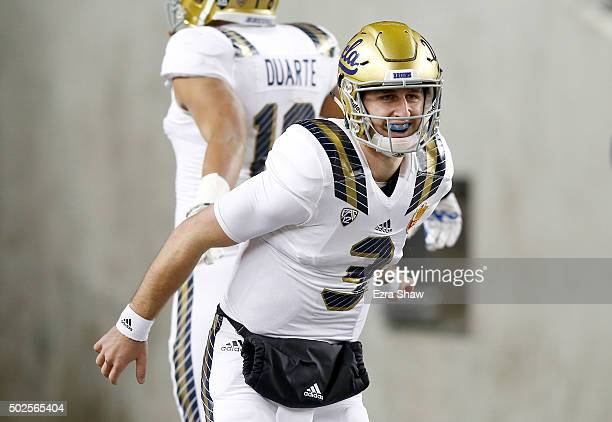 Josh Rosen of the UCLA Bruins reacts after he threw a touchdown pass to Kenneth Walker III against the Nebraska Cornhuskers during the Foster Farms...
