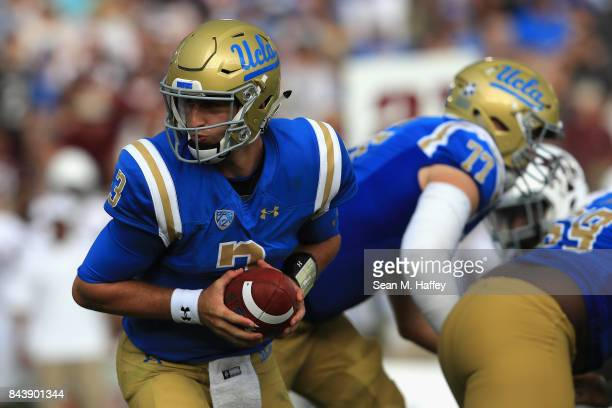 Josh Rosen of the UCLA Bruins takes a snap during the first half of a game against the Texas AM Aggies at the Rose Bowl on September 3 2017 in...