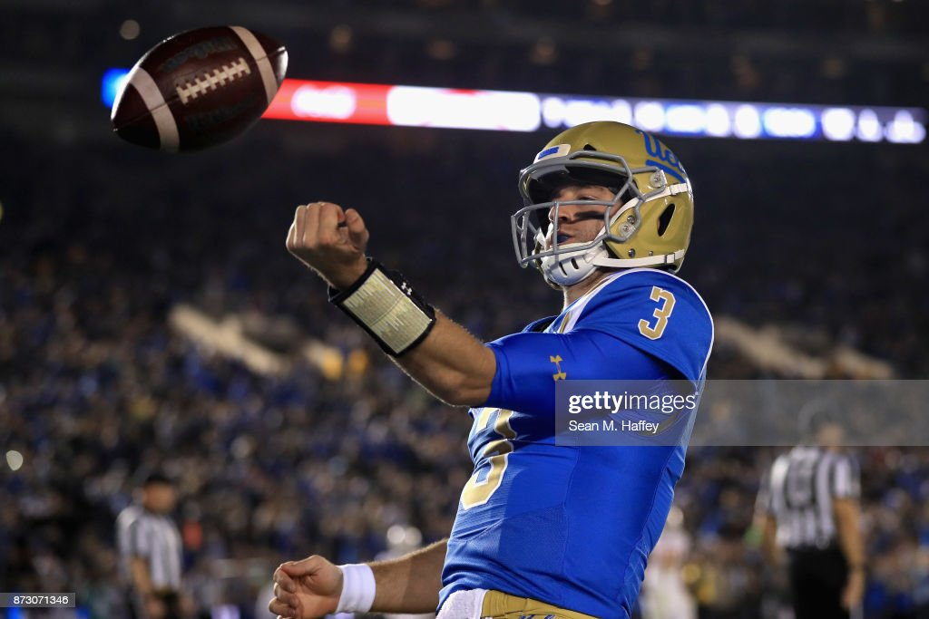 Josh Rosen #3 of the UCLA Bruins tosses the ball after scoring a touchdown on a short run during the first half of a game against the Arizona State Sun Devils at the Rose Bowl on November 11, 2017 in Pasadena, California.