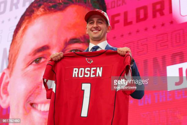 Josh Rosen poses with a jersey after being chosen by the Arizona Cardinals with the tenth overall pick during the first round at the 2018 NFL Draft...