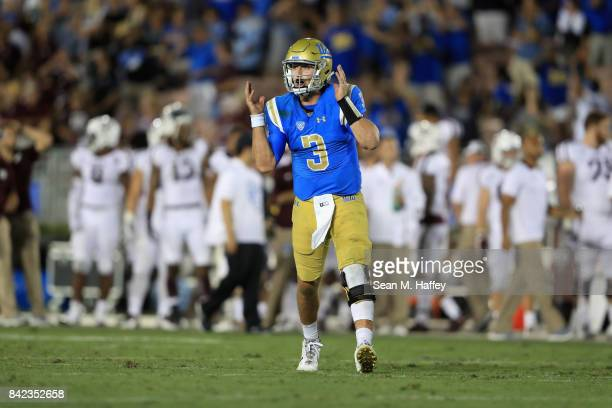 Josh Rosen reacts to throwing a touchdown to Jordan Lasley of the UCLA Bruins during the second half of a game against the Texas AM Aggies at the...