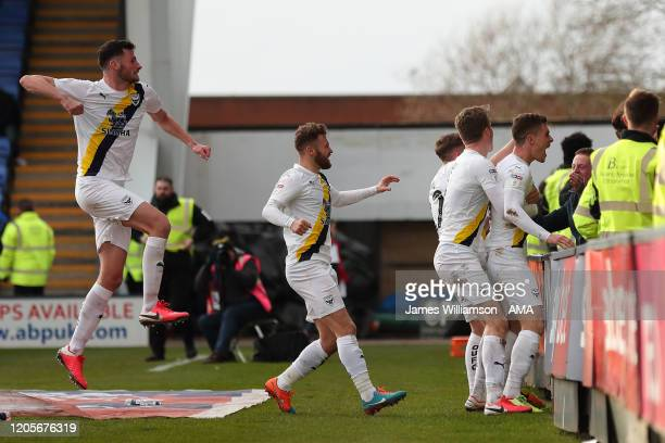 Josh Ruffels of Oxford United celebrates after scoring a goal to make it 23 during the Sky Bet League One match between Shrewsbury Town and Oxford...