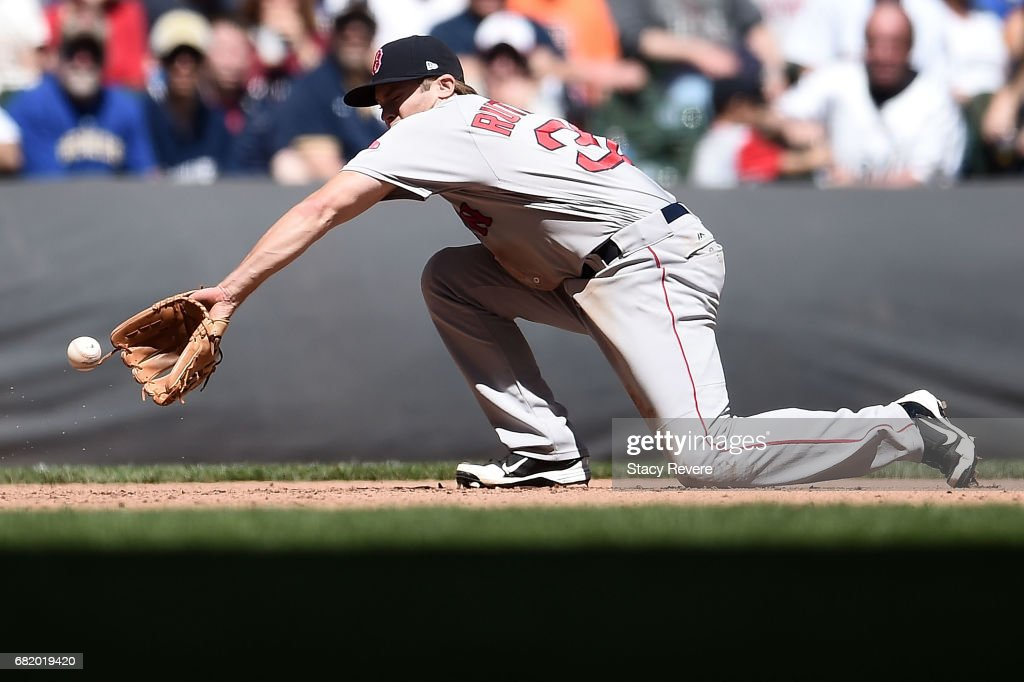 Josh Rutledge #32 of the Boston Red Sox fields a ground ball during the seventh inning of a game against the Milwaukee Brewers at Miller Park on May 11, 2017 in Milwaukee, Wisconsin.
