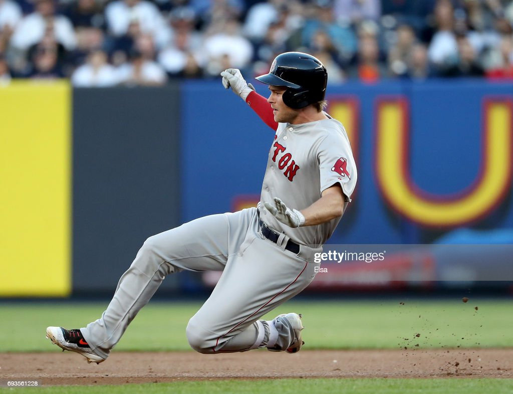 Josh Rutledge #32 of the Boston Red Sox hits a double in the second inning against the New York Yankees on June 7, 2017 at Yankee Stadium in the Bronx borough of New York City.