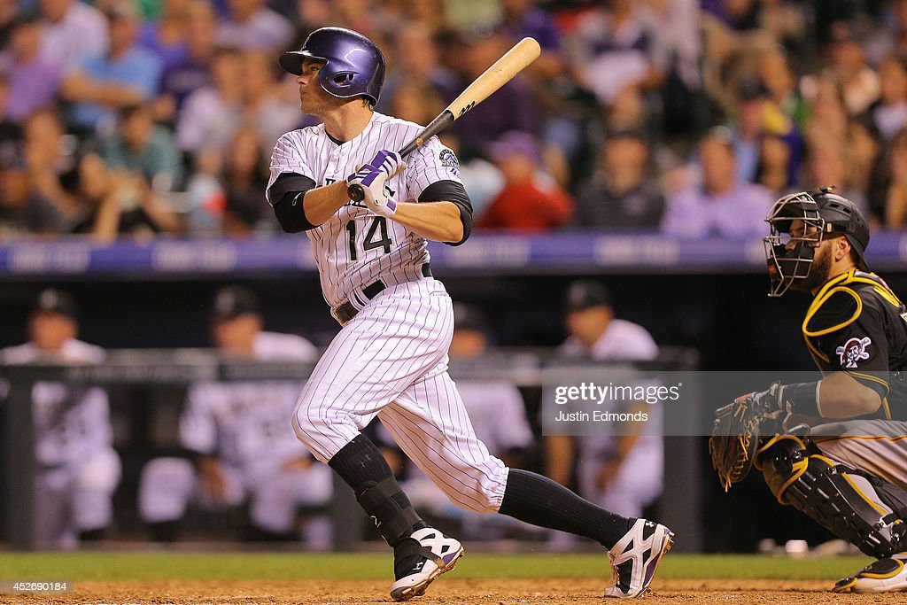 Josh Rutledge #14 of the Colorado Rockies hits a three RBI double during the seventh inning against the Pittsburgh Pirates at Coors Field on July 25, 2014 in Denver, Colorado.