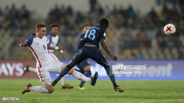 Josh Sargent of the United States battles for the ball with Steven Sessegnon of England during the FIFA U17 World Cup India 2017 Quarter Final match...
