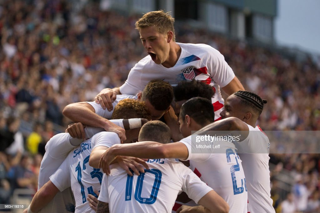 Josh Sargent #13 of United States celebrates his goal with Christian Pulisic #10, Walker Zimmerman #4, Rubio Rubin #23 and Weston McKennie #6 in the second half of the friendly soccer match against Bolivia at Talen Energy Stadium on May 28, 2018 in Chester, Pennsylvania. The United States defeated Bolivia 3-0.