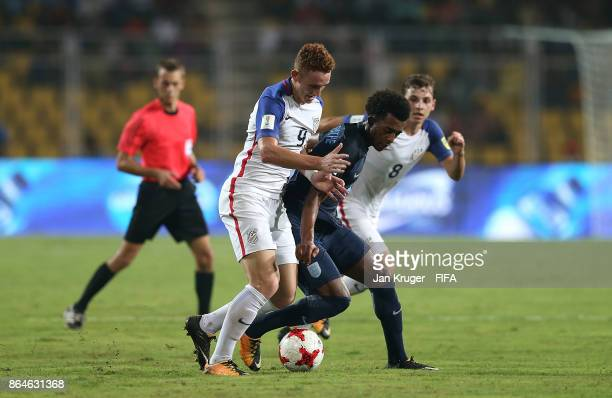 Josh Sargent of United States of America battles with Tashan OakleyBoothe of England during the FIFA U17 World Cup India 2017 Quarter Final match...