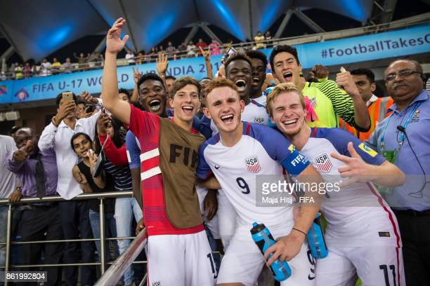 Josh Sargent of USA and his teammates celebrate after winning the FIFA U17 World Cup India 2017 Round of 16 match between Paraguay and USA at...