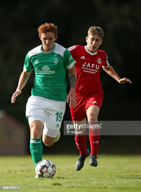 Josh Sargent of Werder Bremen and Anton Krivolapov of Bremerhaven battle for the ball during the friendly match between OSC Bremerhaven and Werder...