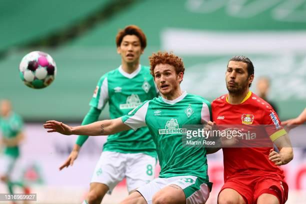 Josh Sargent of Werder Bremen battles for possession with Aleksandar Dragovic of Bayer Leverkusen during the Bundesliga match between SV Werder...