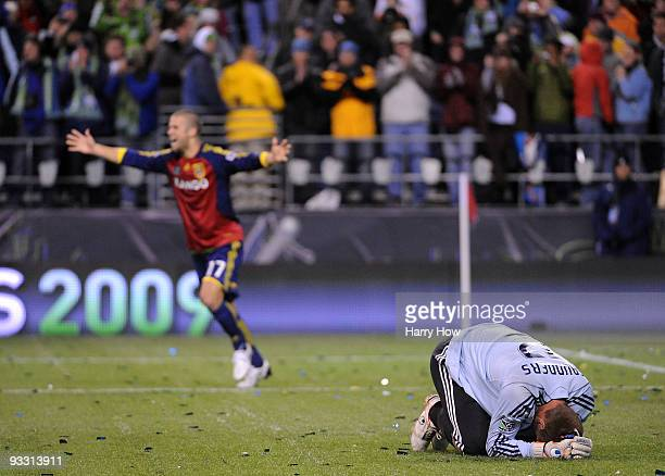 Josh Saunders of the Los Angeles Galaxy reacts after allowing the game winning goal as Chris Wingert of Real Salt Lake celebrates during the MLS Cup...