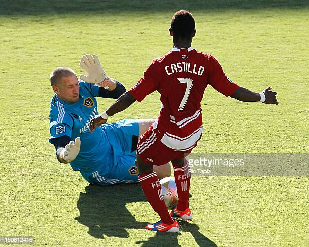 Josh Saunders of Los Angeles Galaxy makes a save against Fabian Castillo of FC Dallas during the MLS match at The Home Depot Center on August 26 2012...