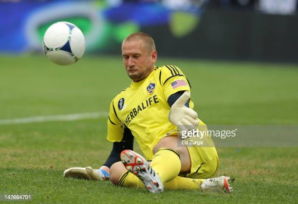 Josh Saunders of the Los Angeles Galaxy knocks the ball away from the goal during a game against Sporting Kansas City at Livestrong Sporting Park on...