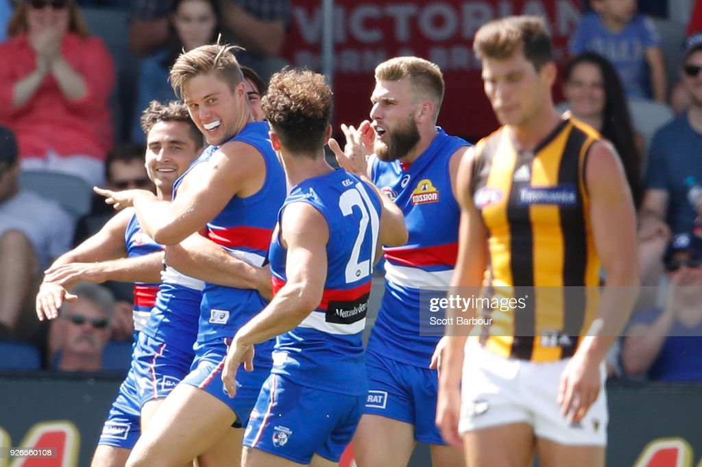Josh Schache of the Bulldogs is congratulated by his teammates after kicking his first goal during the AFL JLT Community Series match between the Western Bulldogs and the Hawthorn Hawks at Mars Stadium on March 3, 2018 in Ballarat, Australia.