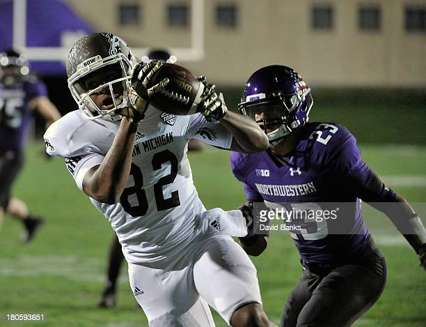 Josh Schaffer of the Western Michigan Broncos catches a touchdown pass as he's defended by Nick VanHoose of the Northwestern Wildcats during the...