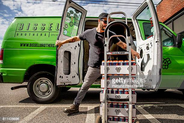 Josh Schlesinger owner of Sleek Machine Distro closes the doors to his delivery van as he prepares to offload cases of Bissell Brothers bucolia beer...
