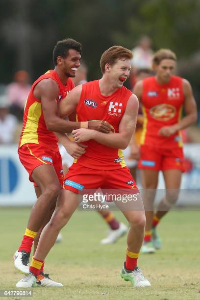 Josh Schoefeld of the Suns celebrates a goal during the 2017 JLT Community Series match at Broadbeach Sports Centre on February 19 2017 in Gold Coast...