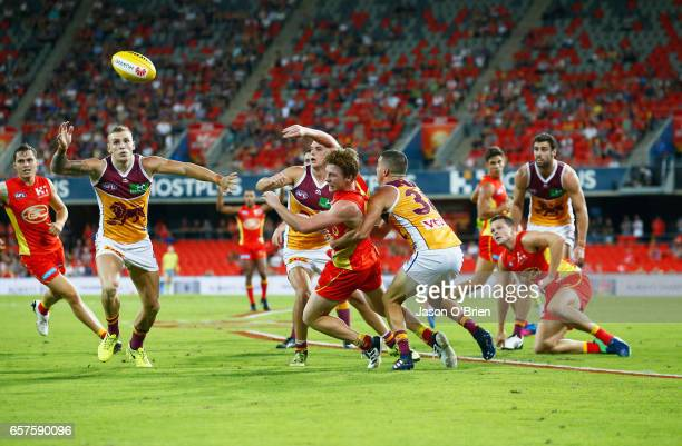 Josh Schoenfeld of the Suns in action during the round one AFL match between the Gold Coast Suns and the Brisbane Lions at Metricon Stadium on March...