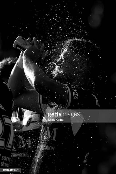 Josh Schuster of the Sea Eagles sprays himself with water during the NRL Trial Match between the Wests Tigers and the Manly Sea Eagles at Leichhardt...
