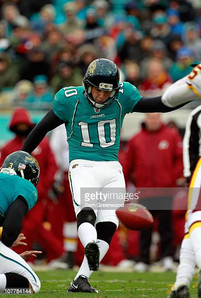 Josh Scobee of the Jacksonville Jaguars attempts an extra point during the game against the Washington Redskins at EverBank Field on December 26 2010...