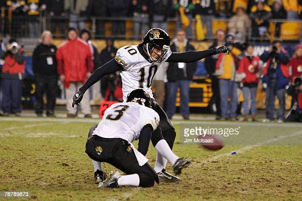 Josh Scobee of the Jacksonville Jaguars kicks the game winning field goal as Adam Podlesh of the Jaguars holds in the final moments of their win over...