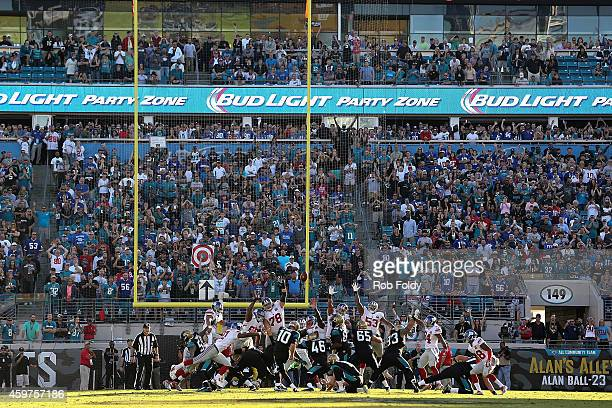 Josh Scobee of the Jacksonville Jaguars kicks the gamewinning field goal during the fourth quarter of the game against the New York Giants at...