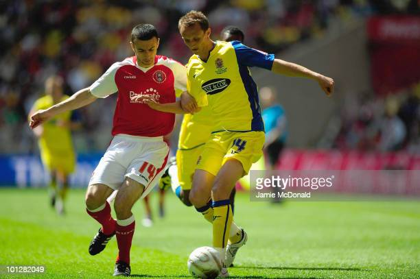 Josh Scott of Dagenham battles with Mark Lynch of Rotherham during the Coca Cola League Two Playoff Final between Dagenham and Redbridge and...
