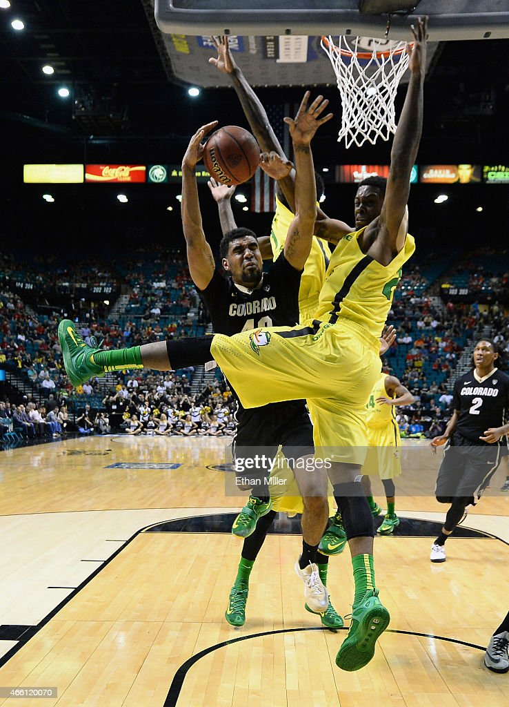 Josh Scott #40 of the Colorado Buffaloes drives to the basket against Elgin Cook #23 of the Oregon Ducks during a quarterfinal game of the Pac-12 Basketball Tournament at the MGM Grand Garden Arena on March 12, 2015 in Las Vegas, Nevada. Oregon won 93-85.