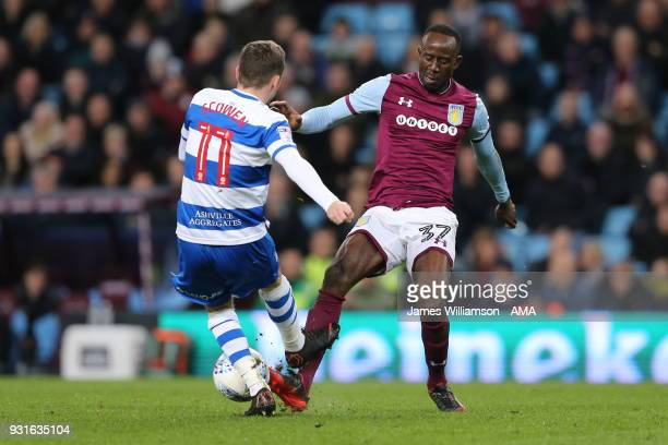 Josh Scowen of Queens Park Rangers and Albert Adomah of Aston Villa during the Sky Bet Championship match between Aston Villa and Queens Park Rangers...