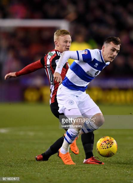 Josh Scowen of Queens Park Rangers is challenged by Mark Duffy of Sheffield United during the Sky Bet Championship match between Sheffield United and...