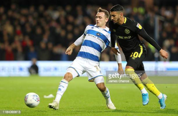 Josh Scowen of Queens Park Rangers is challenged by Said Benrahma of Brentford during the Sky Bet Championship match between Queens Park Rangers and...