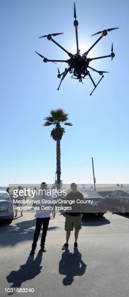 Josh Sharfi, left, and Adam Gibson, fly an octocopter at a beach in Venice on Tuesday. The pair work at Ctrl Me in Venice. These guys are drone...