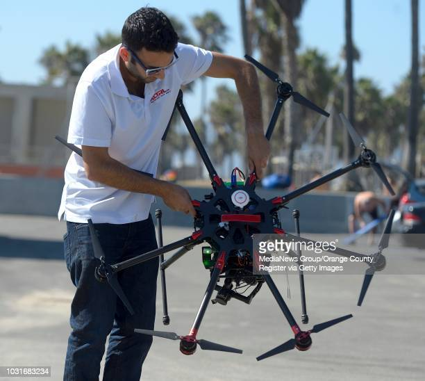 Josh Sharfi sets up an octocopter at a beach in Venice on Tuesday. The pair work at Ctrl Me in Venice. These guys are drone enthusiasts who make the...