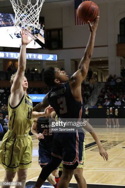 Josh Sharkey guard for Samford makes a reverse lay up during college basketball game between the Samford Bulldogs and the Wofford Terriers on January...
