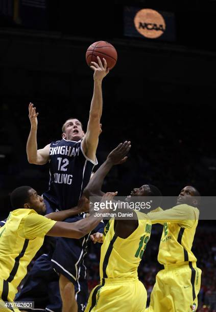 Josh Sharp of the Brigham Young Cougars shoots over Mike Moser, Richard Amardi, and Jason Calliste of the Oregon Ducks during the second round game...