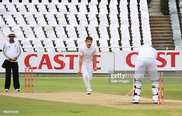Josh Shaw of England bowls Vasili Orros of South Africa during day four of the Under19 first Youth Test match between South Africa and England at...