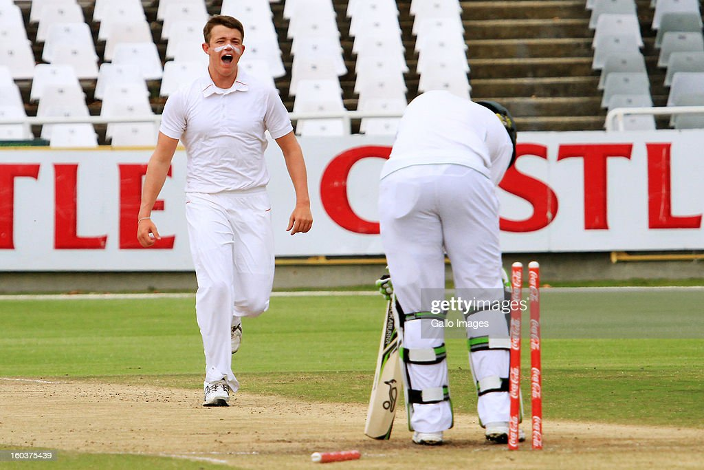 Josh Shaw of England celebrates the wicket of Vasili Orros of South Africa during day four of the Under-19 first Youth Test match between South Africa and England at Sahara Park Newlands on January 30, 2013 in Cape Town, South Africa.