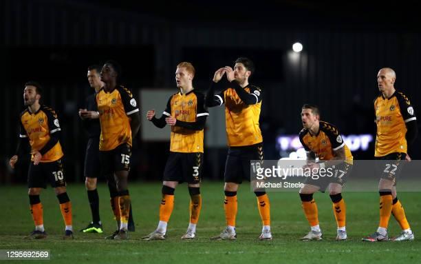 Josh Sheehan, David Longe-King, Ryan Haynes, Jamie Proctor, Scot Bennett and Kevin Ellison of Newport County react as teammate Liam Shephard misses a...
