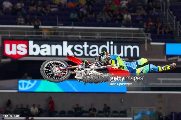 Josh Sheehan grabs his dirtbike during Moto X Freestyle at X Games Minneapolis on July 14 2017 at US Bank Stadium in Minneapolis Minnesota