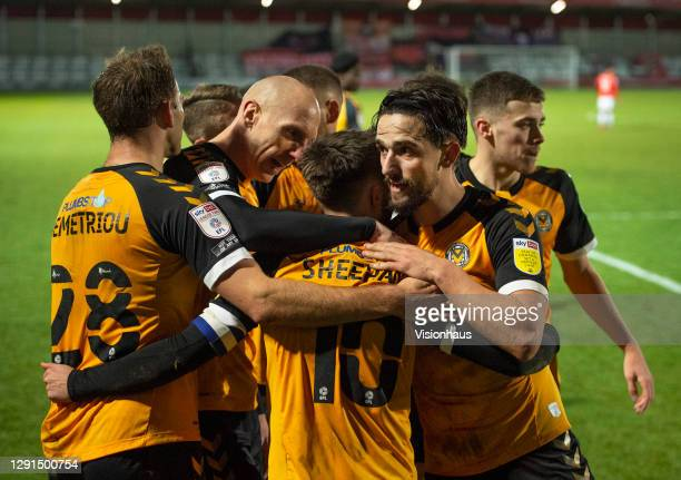 Josh Sheehan of Newport county celebrates scoring his teams' equalising goal with team mates Mickey Demetriou, Liam Shephard and Kevin Ellison during...