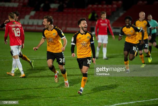 Josh Sheehan of Newport county celebrates scoring his teams' equalising goal with team mate Mickey Demetriou during the Sky Bet League Two match...